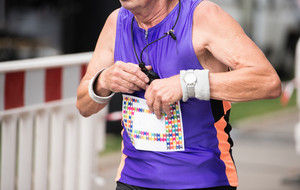Unrecognizable senior runner outdoors. Sportive man competing in a urban area, healthy lifestyle and sport concepts.