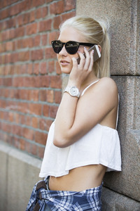 Urban and cute girl talking on the phone