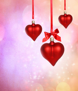 Valentine heart ornaments with pink grunge background