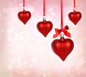 Valentine heart ornaments with pink light background