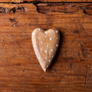 Valentines day composition. Studio shot on brown wooden background.