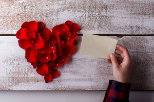 Valentines day composition. Studio shot on white wooden background.