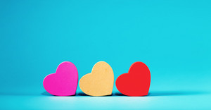 Valentine's day heart ornaments on a blue background