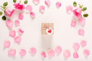 Valentines Day theme with rose petals and gift box
