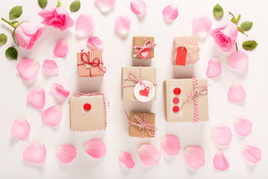 Valentines Day theme with rose petals and gift boxes