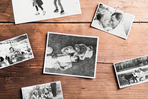 Various black and white pictures of senior couple in love. Studio shot on wooden background.