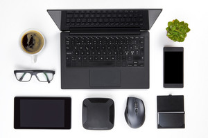 Various Devices Arranged On White Office Desk