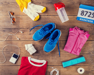 Various running stuff laid on a wooden floor background