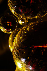 Vertical image of disco balls sparkling in darkness