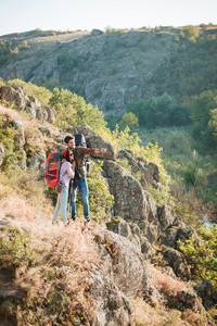 Vertical image of traveling couple near the canyon. full length image