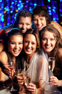 Vertical shot of group of young women having fun at wedding party