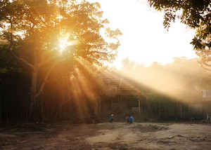 Vietnamese children playing outside their house at the sunset