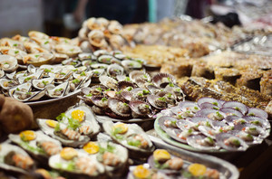 Vietnamese street market with beautifully prepared seafood