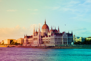 View of Hungarian parliament in Budapest, Hungary on the riverbank of Danube river. Filtered with vintage color preset
