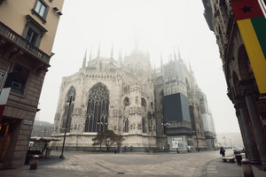 View of the Milan Cathedral with fog that covers the pinnacles of Minster