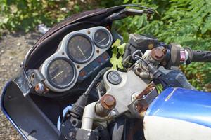 Vintage motorbike. Devices on a steering bracket on the old bike.