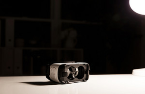 Virtual reality headset device on desk at night