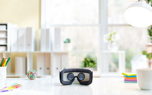Virtual reality headset device on desk in a bright interior office