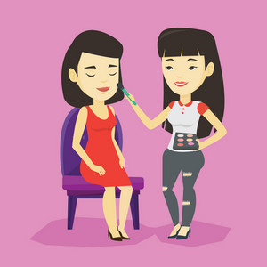 Visagiste applying makeup with a brush on woman face. Visagiste doing makeup to young asian woman. Visagiste doing makeup to a model using a brush. Vector flat design illustration. Square layout.
