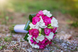 Wedding bouquet with pink roses laid on the ground