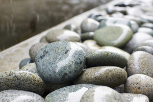 Wet stones , shallow depth of field.