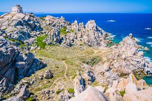 White lighthouse of Capo Testa in north Sardinia, Huge Granite Rocks in front