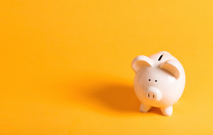 White piggy bank on a yellow background