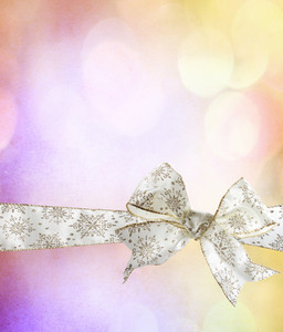 White Snowflake Bow and Ribbon with Abstract Lights Background