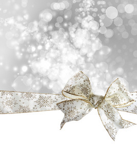 White Snowflake Bow and Ribbon with Bokeh Lights Background