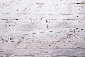 White wooden plank as empty background. Studio shot.