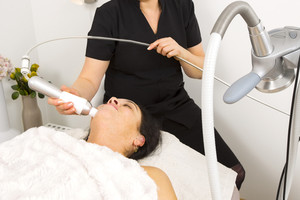 Woman get face treatment at beauty clinic