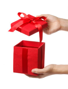 Woman holding a red gift box on white background