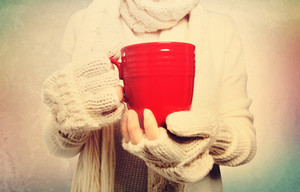 Woman holding a red mug in vintage style