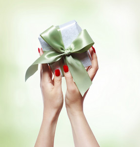 Woman Holding a Small Gift Box