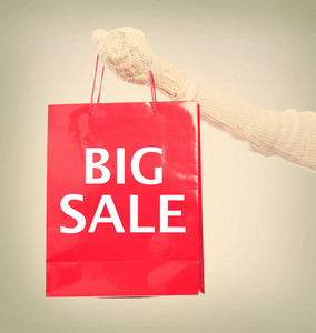 Woman holding Big Sale red shopping bag