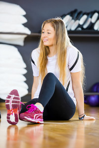 Woman Looking Away While Sitting In Gym
