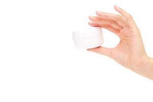 Woman presenting a hand cream
