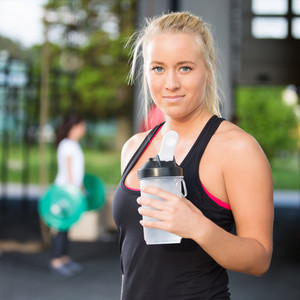 Woman rest and drinking water after workout