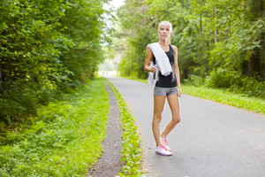 Woman runner rests after workout outdoor