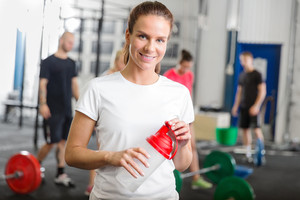 Woman taking a break at fitness gym center