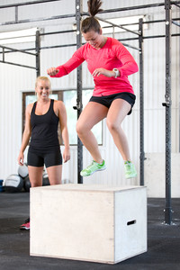 Woman trains box jumps with her team