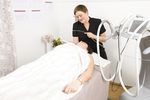 Woman undergoes face treatments at beauty clinic