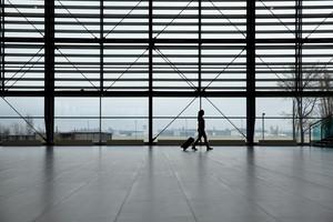 Woman walking in airport terminal