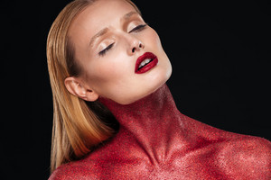 Woman with red body. Close up portrait. Black background
