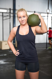 Woman with slam ball at fitness gym center