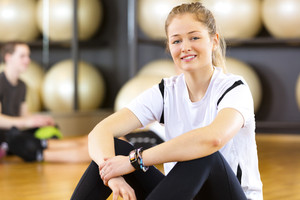 Workout portrait of a smiling woman at fitness center