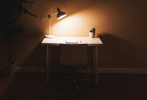 Workstation desk in a large room at night