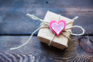 Wrapped package with decorative heart on its top