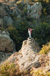 Young adventure woman near the canyon. vertical image