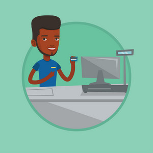 Young african-american cashier holding credit card at the checkout in supermarket. Cashier working at checkout in a supermarket. Vector flat design illustration in the circle isolated on background.